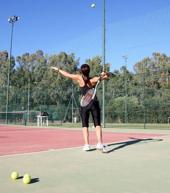 Guest playing Tennis